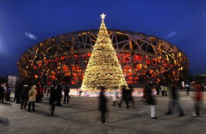 People walk around a Christmas tree outside the Bird's Nest in Beijing