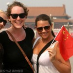 """Foreign tourists pose for photos on the Tiananmen Square in Beijing, China, 24 September 2009."""